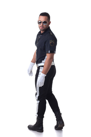 a policeman: Studio shot of trendy serious policeman, isolated on white Stock Photo
