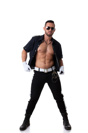 costumes: Image of sexy muscular cop posing at camera, isolated on white