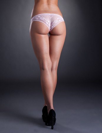 booty: Rear view of leggy model with elastic ass, close-up