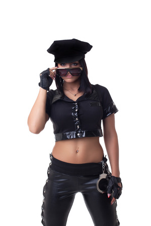 Studio shot of sexy police woman with pierced navel Banque d'images