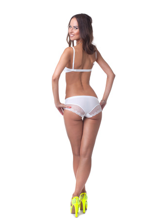 sexy woman panties: Sexy woman posing in white lingerie and yellow shoes