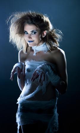 mummified: Fashion snapshot - funny model posing dressed as mummy