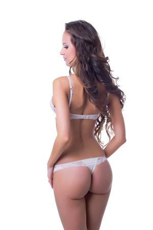 Portrait of curvy slim model posing back to camera photo