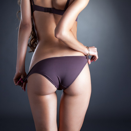 Image of models ass in panties, close-up photo