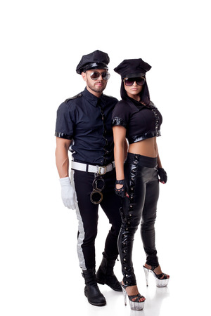 Two sexy strippers dressed in police costume, isolated on white