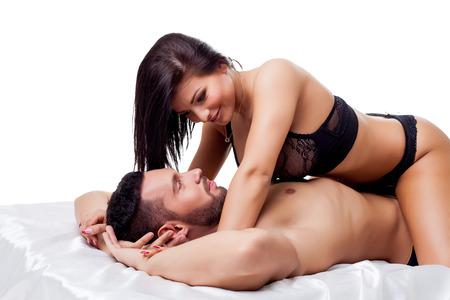 man and woman sex: Страстные любители позирует, лежа в студии, изолированных на белом Фото со стока