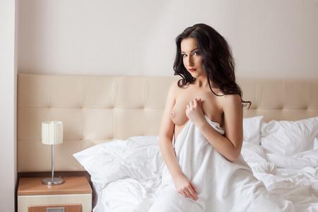 topless brunette: Image of topless brunette posing in hotel bedroom
