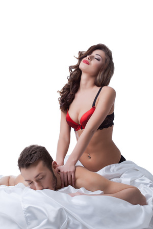 erotic male: Sexy young woman doing massage to her lover, isolated on white