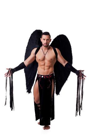 Sexy male stripteaser dressed in suit of fallen angel photo