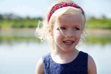 hair band: Image of funny blonde girl with hair band, close-up