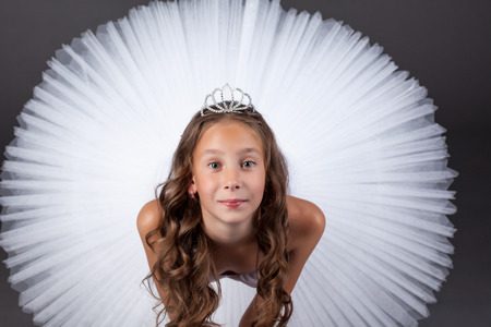 ballet child: Top view of young ballerina posing looking at camera