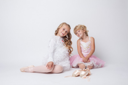 gym dress: Image of lovely little ballerinas posing at camera