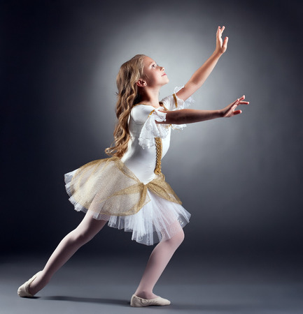 Image of lovely little ballerina dancing at camera