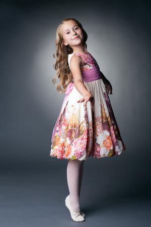 kids dress: Image of smiling little dancer posing in studio