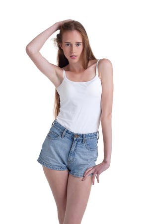 Long-haired skinny model isolated on white backdrop Stock Photo