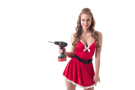 busty: Beautiful busty model dressed as Santa advertises drill Stock Photo