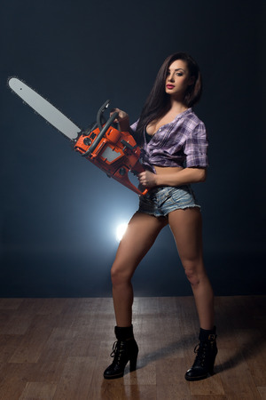 Studio shot of beddable model advertises chainsaw
