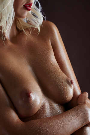 wet breast: Close-up of beautiful womans breasts in water drops Stock Photo
