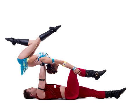 acrobat gymnast: Sexy Santa and Maiden performs acrobatic stunts, isolated on white Stock Photo