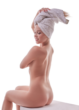 naked young people: Image of smiling girl posing nude after shower in studio