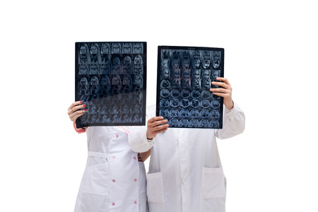 tomogram: Image of doctors holding tomograms in front of them