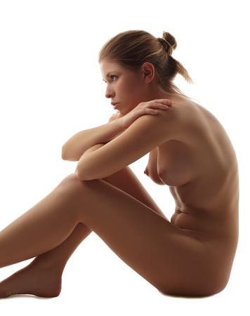nude girl sitting: Studio shot of pretty nude girl sitting, isolated on white