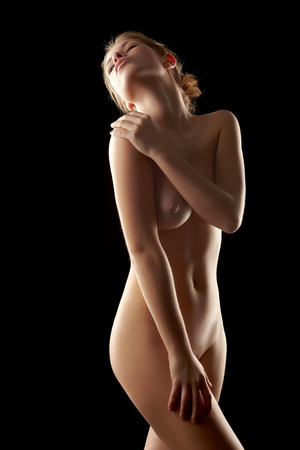 Languid young woman with perfect body posing naked Stock Photo