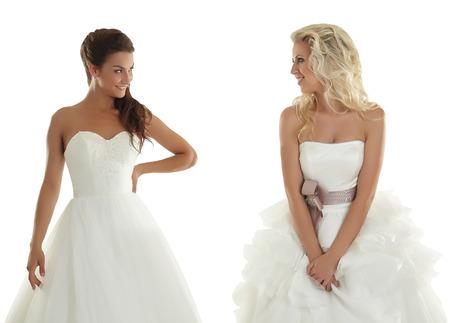 Two lovely girlfriends in wedding dresses, isolated on white Standard-Bild