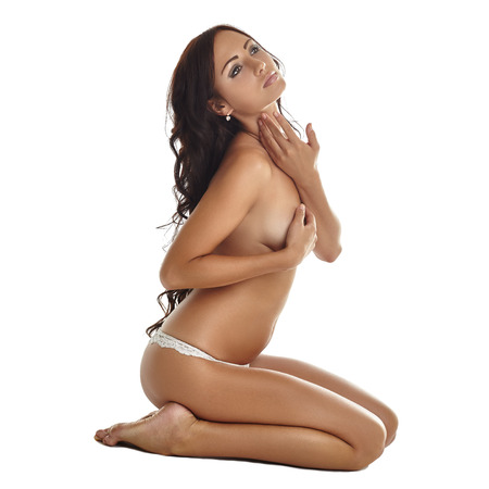 brunette naked: Seductive tanned brunette posing topless, isolated on white