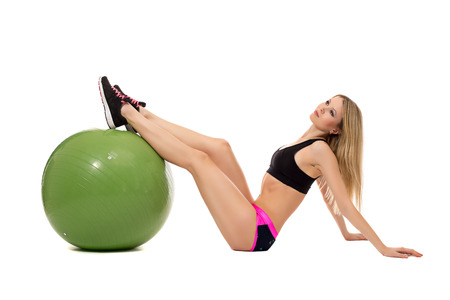 shaping: Dreamy female athlete threw her feet on fitness ball