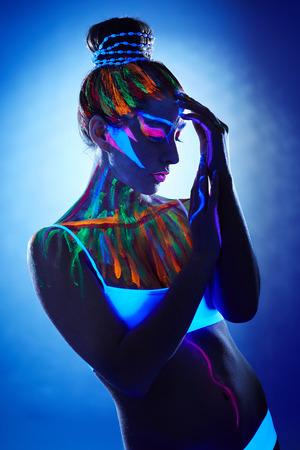 light blue lingerie: Portrait of beautiful girl with creative body art posing in UV light