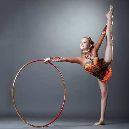 Image of adorable rhythmic gymnast doing vertical split