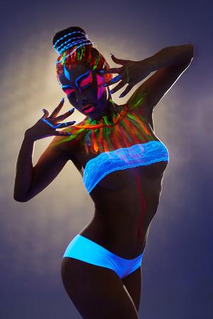 light blue lingerie: Image of seductive female dancer with luminous body art Stock Photo