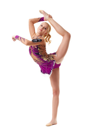 Free callisthenics. Adorable gymnast posing with maces photo