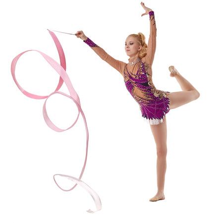 gymnastics equipment: Studio photo of artistic gymnast dancing with ribbon Stock Photo