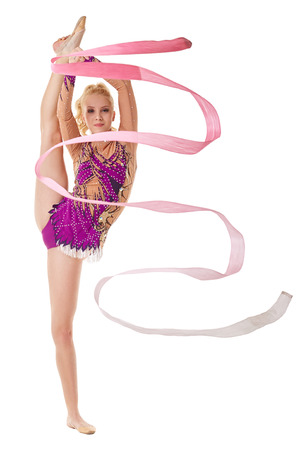 gymnastics equipment: Free callisthenics. Lovely gymnast dancing with ribbon Stock Photo