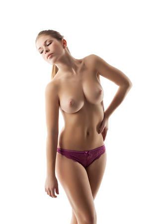 Studio shot of sensual topless girl with elastic breasts
