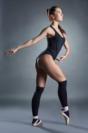 gaiters: Image of beautiful contemporary ballerina warms up in studio