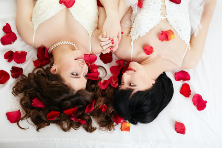 lesbians: Gay marriage. Top view of happy girls in bridal dresses Stock Photo