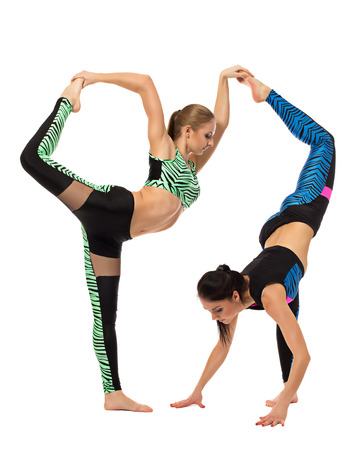 acrobatic: Acrobatic composition of two flexible girls, isolated on white