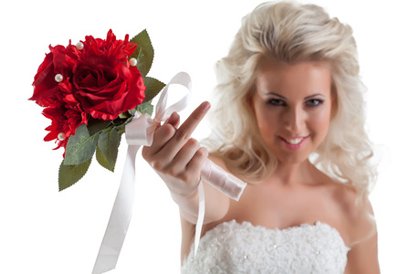 naughty woman: Portrait of naughty bride shows rude gesture at camera