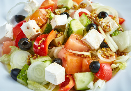 flavoured: Delicious Greek salad made of fresh vegetables and feta cheese