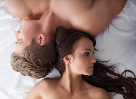 sex on bed: Concept of sexual frustration. Lovers ignore each other Stock Photo