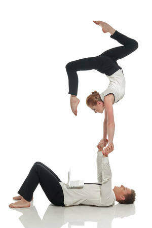 acrobatic: Acrobatic business people doing handstand in pair, isolated on white