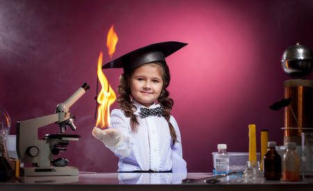 conducts: Image of cute girl conducts physical experience in lab