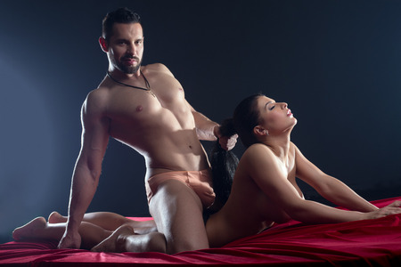 nude sex: Domineering macho passionately having sex with his mistress Stock Photo