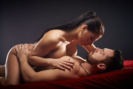 Studio photo of passionate couple having sex, close-up Stock Photo