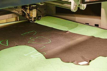 Close-up of laser marking on skin for cutting. Footwear production