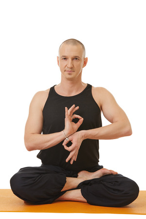 mudra: Image of yoga instructor posing with hands in mudra
