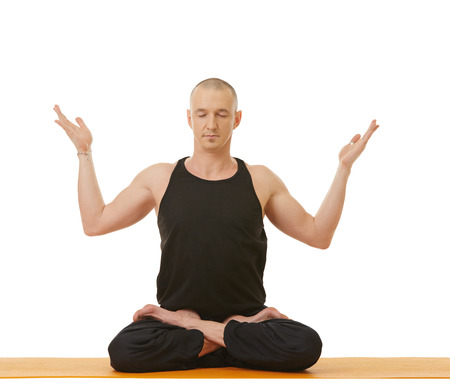 Meditator man posing in lotus position, isolated on white
